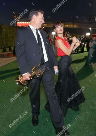 """Mathew Waters, left, and Onnalee Blank winners of the award for outstanding sound mixing for a comedy or drama series (one-hour) for """"Game of Thrones"""" at the Governors Ball for night one of the Television Academy's 2016 Creative Arts Emmy Awards at the Microsoft Theater on in Los Angeles"""