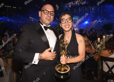 """Chi-Yoon Chung winner of the award for Outstanding Single-Camera Picture Editing for """"The People v. O.J. Simpson: American Crime Story"""", right, and Larry Love at the Governors Ball for night one of the Television Academy's 2016 Creative Arts Emmy Awards at the Microsoft Theater on in Los Angeles"""