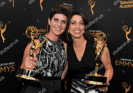 Moira Demos, left, and Laura Ricciardi pose for a portrait during night two of the Television Academy's 2016 Creative Arts Emmy Awards at the Microsoft Theater on in Los Angeles