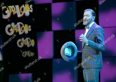 "Stock Image of Timothy Omundson performs â?œIâ?™ll Knowâ?? from the musical â?œGuys and Dollsâ?? at the 24th annual Alzheimer's Association ""A Night at Sardi's"" at the Beverly Hilton hotel, in Beverly Hills, Calif"