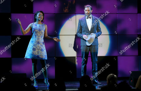 "Karen David, left, and Timothy Omundson perform I'll Know from the musical Guys and Dolls at the 24th annual Alzheimer's Association ""A Night at Sardi's"" at the Beverly Hilton hotel, in Beverly Hills, Calif"