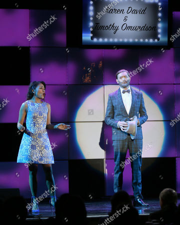 "Stock Picture of Karen David, left, and Timothy Omundson perform I'll Know from the musical Guys and Dolls at the 24th annual Alzheimer's Association ""A Night at Sardi's"" at the Beverly Hilton hotel, in Beverly Hills, Calif"