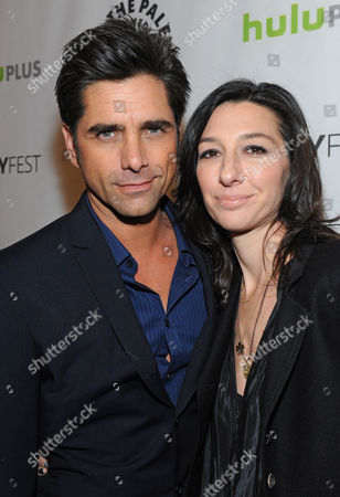 Photo of John Stamos, left, and Ali Adler courtesy of Samsung Galaxy, taken during the Paley Center for Media's PaleyFest, honoring The New Normal, at the Saban Theatre, in Los Angeles, California