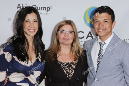 """Lisa Ling, from left, Kay Buck, and Jericho Rosales arrives at The CAST 15th Annual """"From Slavery To Freedom"""" Event at Sofitel Los Angeles on in Los Angeles"""