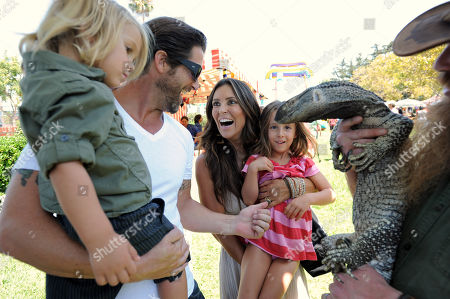 Grant Reynolds, second left, Jillian Barberie, third left, and their children attend The HollyRod Foundation's 3rd Annual My Brother Charlie Family Fun Festival at Culver Studios, in Culver City, Calif