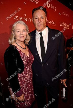 Karen Landry, left, and Chris Mulkey arrive at The Hollywood Reporter Nominees Night presented by Cadillac, Bing, Delta, Pandora jewelry, Qua, and Zenith, at Spago, in Beverly Hills, Calif