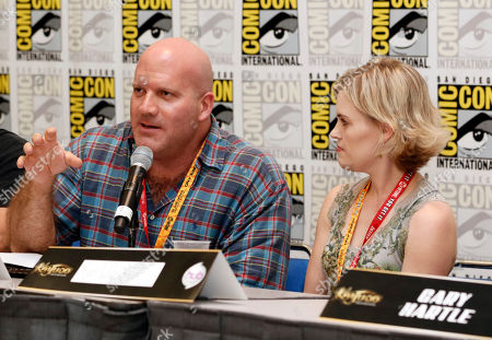"""David Sobolov, left, and Kari Wahlgren participate in the """"Kaijudo: Rise of the Duel Masters"""" panel at Comic-Con, in San Diego, Calif"""