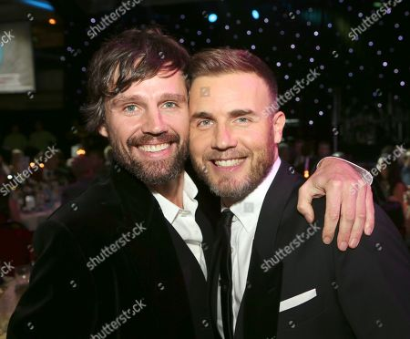 FILE - Jason Orange, left, and Gary Barlow seen at the 2012 Music Industry Trusts Award ceremony at the Grosvenor House Hotel, in London