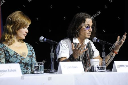 "From left, producer Lorri Davis, and actor Johnny Depp participate in a photo call and press conference for the film ""West of Memphis"" at TIFF Bell Lightbox during the Toronto International Film Festival on in Toronto"