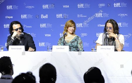 "From left, producer Damien Echols, producer Lorri Davis, and actor Johnny Depp participate in a photo call and press conference for the film ""West of Memphis"" at TIFF Bell Lightbox during the Toronto International Film Festival on in Toronto"