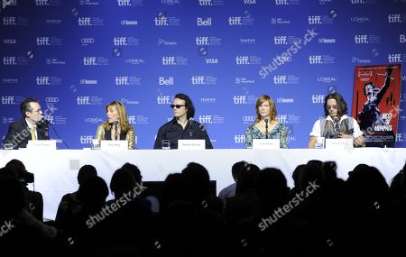 "Panelists, from left, moderator Thom Powers, director Amy Berg, producer Damien Echols, producer Lorri Davis, and actor Johnny Depp participate in a photo call and press conference for the film ""West of Memphis"" at TIFF Bell Lightbox during the Toronto International Film Festival on in Toronto"