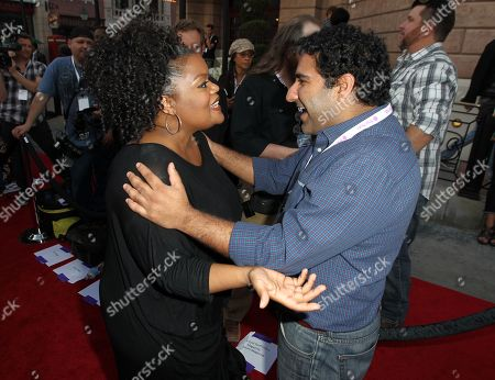 """Actors Yvette Nicole Brown, left, and Parvesh Cheena arrive at The Hub's """"Transformers Prime Beast Hunters"""" World Premiere Screening Event on in Universal City, Calf"""