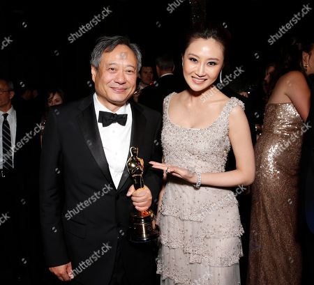 Director Ang Lee and Lin Peng attend the Twentieth Century Fox And Fox Searchlight Pictures Academy Awards Nominees Party at Lure on in Los Angeles