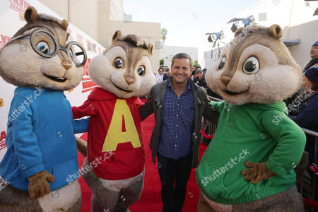 Stock Photo of Director Walt Becker and The Chipmunks seen at Twentieth Century Fox Friends and Family screening of 'Alvin and The Chipmunks: The Road Trip' at Zanuck Theatre, in Los Angeles, CA