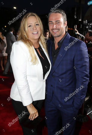 Producer Julie Yorn and Taylor Kinney seen at the Twentieth Century Fox Los Angeles Premiere of 'The Other Woman', in Westwood, Calif
