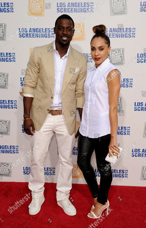 Lance Gross, left, and Rebecca Jefferson arrive at Twentieth Century Fox Television Distribution's 2013 LA Screenings Lot Party on in Los Angeles, California