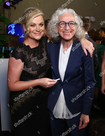 Amy Poehler, left, and Dr. Jane Aronson attend unite4:good and Variety's 2nd annual unite4:humanity at the Beverly Hilton Hotel on Thursday, Feb.19, 2015, in Beverly Hills, Calif
