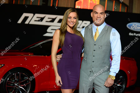 """Tito Ortiz, right and Kristin Ortiz arrive at the US premiere of """"Need for Speed"""",, in Los Angeles"""