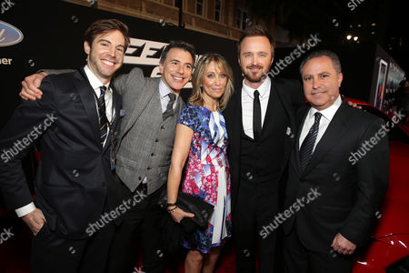 """Jonathan Eirich, SVP of Production at DreamWorks, Ricky Strauss, President of Marketing for Walt Disney Studios, Stacey Snider, Principal Partner, Co-Chairman and CEO of DreamWorks, Aaron Paul and Alan Bergman, President of Walt Disney Studios attend the US Premiere of DreamWorks Pictures """"Need For Speed"""" at The TCL Chinese Theatre in Los Angeles, CA on . """"Need For Speed"""" marks an exciting return to the great car culture films of the 1960s and '70s, when the authenticity of the world brought a new level of intensity to the action on-screen. The film opens in theaters March 14, 2014"""