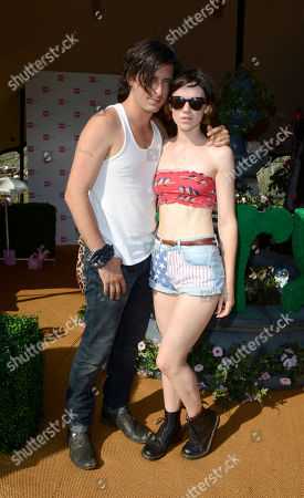 Carl Barat, Edie Langley poses at the Very.co.uk Fashionable Tent in the Virgin Louder Lounge at the V Festival on in Chelmsford, Essex