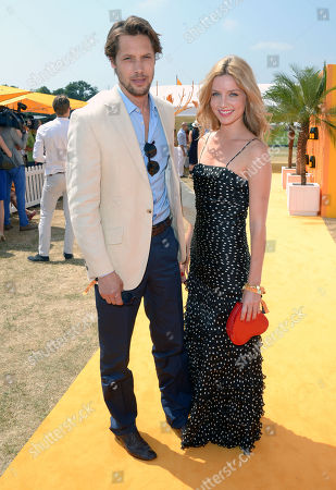 Stock Picture of James Rousseau and Annabelle Wallis attends the Veuve Clicquot Gold Cup Polo Final at Cowdray Park, West Sussex, on