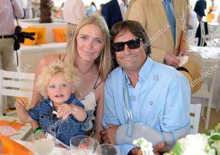 Stock Image of Andrea Vianini, Jodie Kidd and their son Indio attend the Veuve Clicquot Gold Cup Polo Final at Cowdray Park, West Sussex, on
