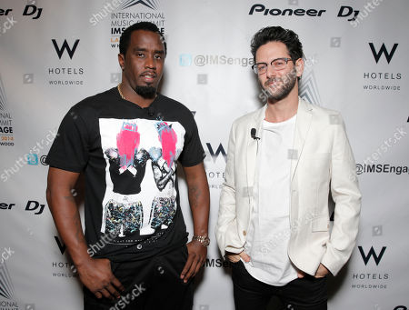 "Sean ""Diddy"" Combs, left, and Guy Gerber arrive at the International Music Summit - IMS Engage at the W Hollywood,, in Los Angeles"