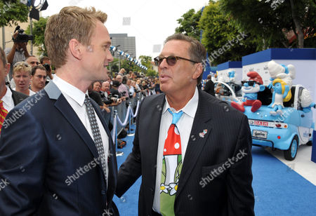 "Actor Neil Patrick Harris, left, and producer Jordan Kerner arrive to the world premiere of ""The Smurfs 2"" at the Regency village Theatre on in Los Angeles"