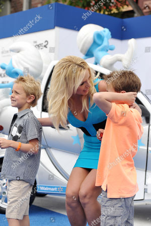 "Singer Britney Spears, center, and sons Sean Federline, left, and Jayden James Federline, right, arrive to the world premiere of ""The Smurfs 2"" at the Regency village Theatre on in Los Angeles"