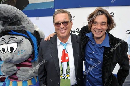 "Stock Picture of Producer Jordan Kerner, left, and composer Heitor Pereira arrive to the world premiere of ""The Smurfs 2"" at the Regency village Theatre on in Los Angeles"