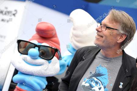 "Director Raja Gosnell arrives on the red carpet at the world premiere of ""The Smurfs 2"" at the Regency village Theatre on in Los Angeles"