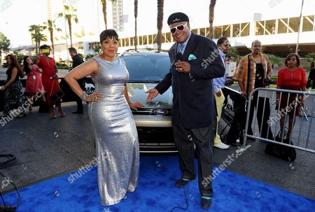 From left, actor Shirley Strawberry and comedian George Wallace arrive at the 11th Annual Ford Neighborhood Awards, on at the MGM Grand Garden Arena in Las Vegas, Nevada