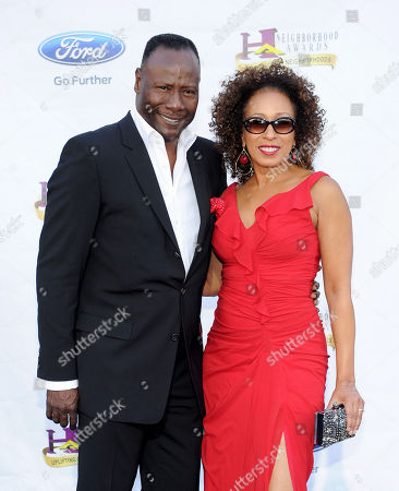 Stock Picture of From left, musician Gregory Generet and actor Tamara Tunie arrive at the 11th Annual Ford Neighborhood Awards, on at the MGM Grand Garden Arena in Las Vegas, Nevada