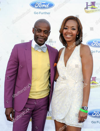 From left, recording artist KEM and Multicultural Marketing Director for Ford, Shawn Thompson arrive at the 11th Annual Ford Neighborhood Awards, on at the MGM Grand Garden Arena in Las Vegas, Nevada