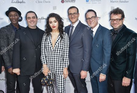 Aloe Blacc, from left, President of the Universal Music Publishing Group Evan Lamberg, Charli XCX, Doug Davis, Ron Fair and Christophe Beck arrive at the 11th annual Songs Of Hope benefit, in Los Angeles