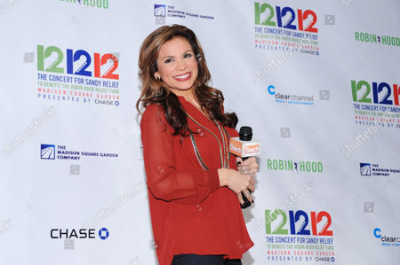 """Carolina Bermudez poses backstage at """"12-12-12"""" The Concert for Sandy Relief, on in New York"""