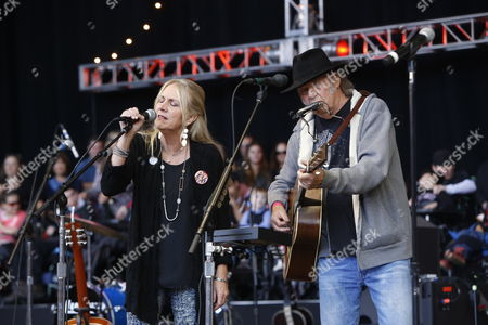 Neil Young and Pegi Young performs on day 2 of the 2013 Bridge School Benefit at Shoreline Amphitheatre on in Mountain View California