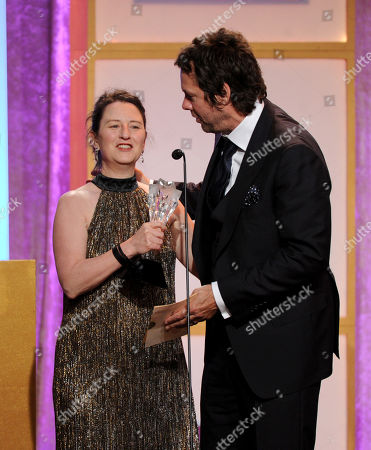 Blair Breard, left, and Dave Becky accept the best actor in a comedy series award for Louis C.K. in 'Louis' at the Critics' Choice Television Awards in the Beverly Hilton Hotel, in Beverly Hills, Calif