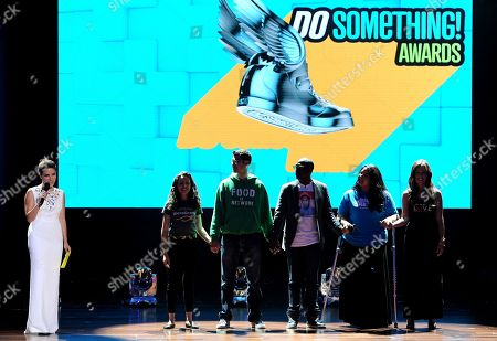 From left, host Sophia Bush, nominees Sasha Fisher of Spark Microgrants, Ben Simon of Food Recovery Network, winning nominee Daniel Maree of Millionhoodies Movement for Justice, and nominees Lorella Praeli of United we DREAM and Jillian Mourning of All We Want is L.O.V.E. are seen onstage at the 2013 Do Something Awards, on in Hollywood, Calif