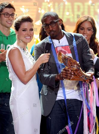 From left, host Sophia Bush and winning nominee Daniel Maree of Millionhoodies Movement for Justice are seen onstage at the 2013 Do Something Awards, on in Hollywood, Calif