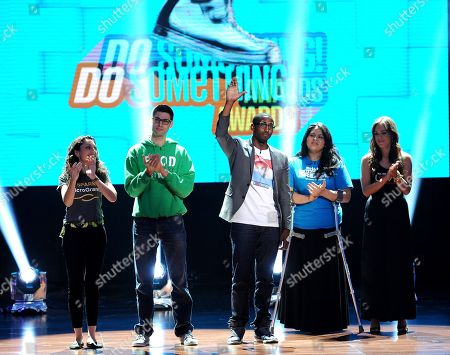 From left, nominees Sasha Fisher of Spark Microgrants, Ben Simon of Food Recovery Network, Daniel Maree of Millionhoodies Movement for Justice, Lorella Praeli of United we DREAM and Jillian Mourning of All We Want is L.O.V.E. are seen onstage at the 2013 Do Something Awards, on in Hollywood, Calif
