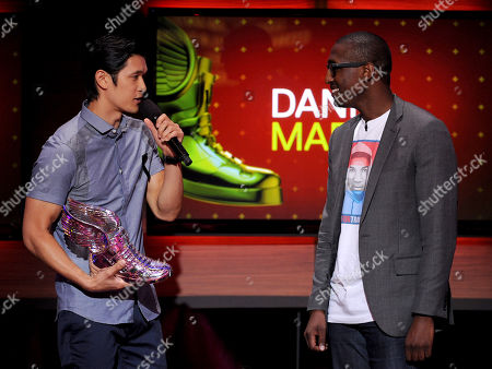Stock Photo of From left, Harry Shum Jr. presents Daniel Maree of Millionhoodies Movement for Justice with an award onstage at the 2013 Do Something Awards, on in Hollywood, Calif