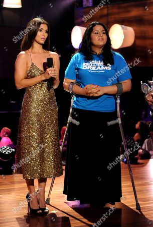 From left, Roselyn Sanchez presents an award to Lorella Praeli of United We DREAM onstage at the 2013 Do Something Awards, on in Hollywood, Calif