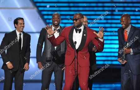 From left, Miami Heat coach Erik Spoelstra and players Dwyane Wade, LeBron James and Ray Allen accept the award for best game at the ESPY Awards, at Nokia Theater in Los Angeles