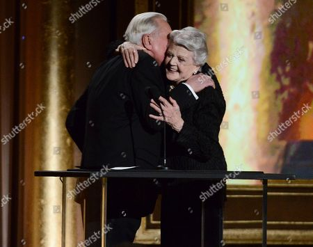 Actress and honoree Angela Lansbury, right, hugs Oscar historian Robert Osborne at the 2013 Governors Awards on in Los Angeles