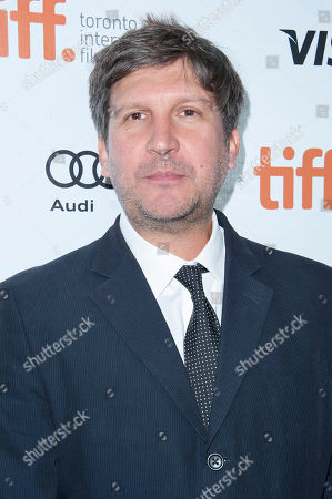 "Director Joel Hopkins arrives at the premiere of ""The Love Punch"" on day 8 of the 2013 Toronto International Film Festival at Roy Thomson Hall on in Toronto"