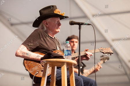 Johnny Winter performs at the New Orleans Jazz and Heritage Festival in New Orleans on