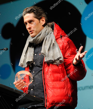 """Stock Photo of Nadav Schirman, director of """"The Green Prince,"""" accepts the Audience Award: World Cinema Documentary during the 2014 Sundance Film Festival Awards Ceremony, in Park City, Utah"""