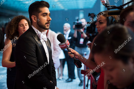 Stock Picture of Vinay Virmani attends the 2015 AMBI Gala benefiting The Prince Albert II of Monaco Foundation at The Four Season Hotel, in Toronto
