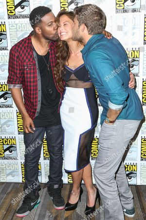 "From left, Jocko Sims, Rhona Mitra, and Travis Van Winkle attend the ""The Last Ship"" press line on day 1 of Comic-Con International, in San Diego"